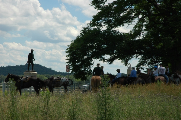 The statue of Gen. Andrew Humphreys overlooks a horseback tour group on the Emmitsburg Road. To the right is the 11th MA. The arm and sword atop it were only recently restored after being torn off by vandals in 2006.