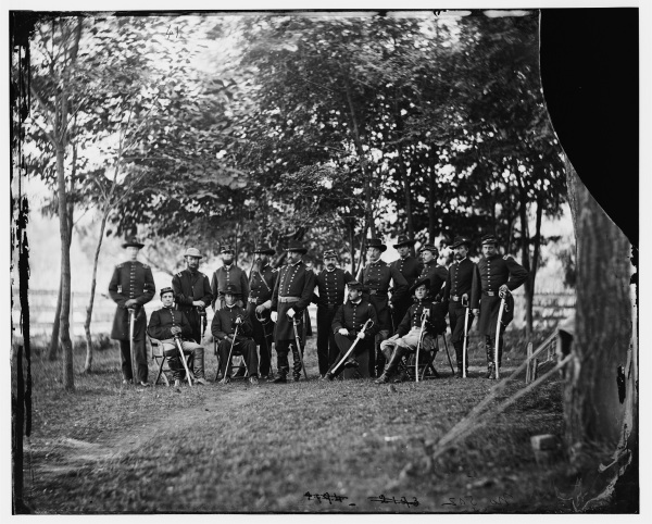 Maj. Gen. William French, commander of the III Corps, poses with his staff outside Culpeper sometime in September 1863. French stands in the group's center, looking slightly to his right. Click on the image to see a larger version (Library of Congress).