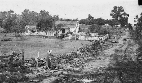 The Lydia Leister house at Gettysburg, which Meade used as his headquarters during the battle. Notice the dead horses in the road. Lyman relates a story about Meade here on July 3, 1863 (Library of Congress).