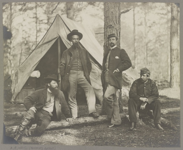Captain Henry J. Sleeper, whom Lyman mentions in his November 15 letter, sits at the right in this photograph showing members of the 10th Massachusetts Battery. This was taken in December 1863. The man on the left is not a battery member--he is artist Alfred Waud (Library of Congress).