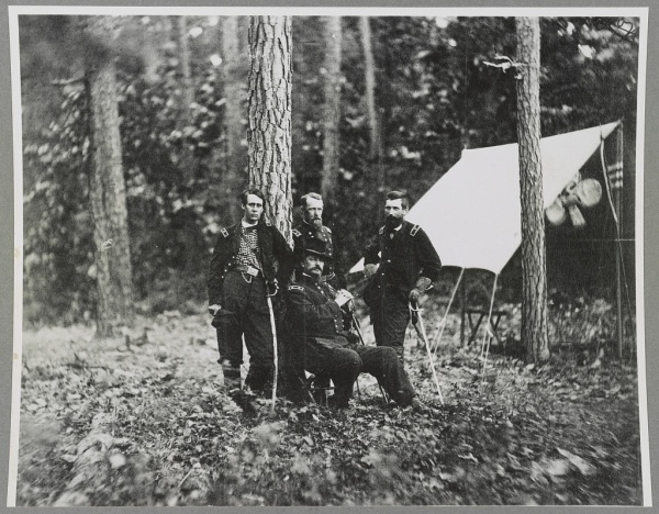 In this image taken at Cold Harbor in 1864, Winfield Scott Hancock (seated) poses with (left to right) Francis Barlow, David Birney, and John Gibbon. Prior to Ulysses S. Grant's promotion to general-in-chief, Birney had supported efforts to get Joe Hooker returned to command of the Army of the Potomac (Library of Congress).