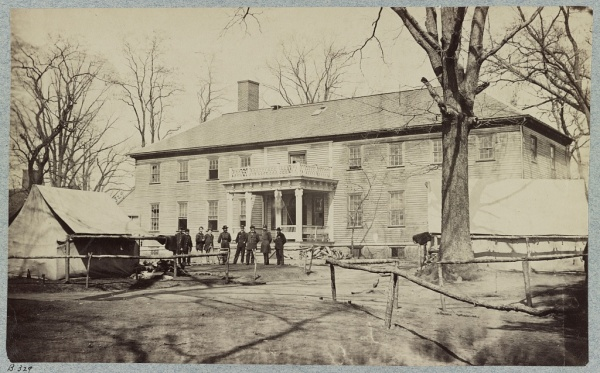 John Sedgwick and staff stand in front by the VI Corps headquarters near Culpeper. Taken in March 1864, this photo shows Sedgwick standing third from right (Library of Congress).