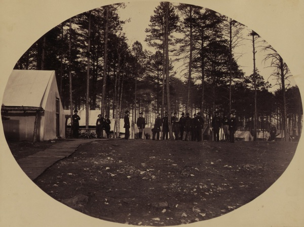 Meade's staff at the general's headquarters at Brandy Station in April 1865. Andrew Humphreys stands facing left in the center (Library of Congress. Click to enlarge).