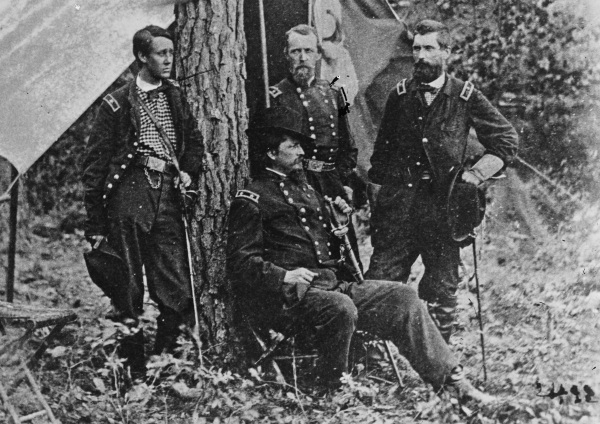 In this image taken at Cold Harbor in 1864, Winfield Scott Hancock (seated) poses with (left to right) Francis Barlow, David Birney, and John Gibbon. Lyman mentions all four generals in his letter of May 20, 1864 (Library of Congress).