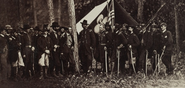Mathew Brady took this photo of Winfield Scott Hancock with his staff and division commanders. Click to enlarge (Library of Congress).