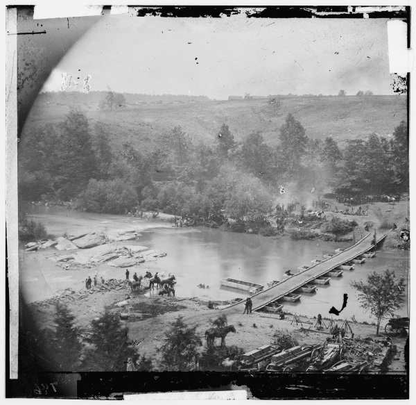 "Photographer Timothy O'Sullivan described this image as ""Jericho Mills, Va. Canvas pontoon bridge across the North Anna, constructed by the 50th New York Engineers; the 5th Corps under Gen. Gouverneur K. Warren crossed here on the 23d. View from the north bank (Library of Congress)."