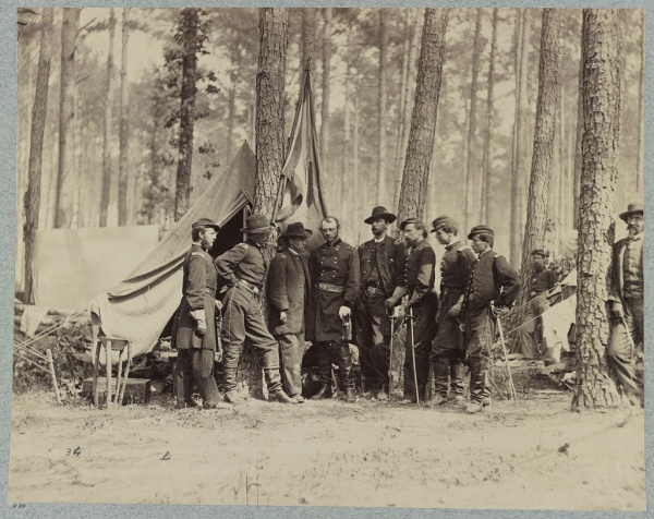 Brigadier General Robert Potter and his staff. Photographer Mathew Brady stands off to the right. This photo was probably taken on June 21, only a few days after Lyman's letter (Library of Congress).