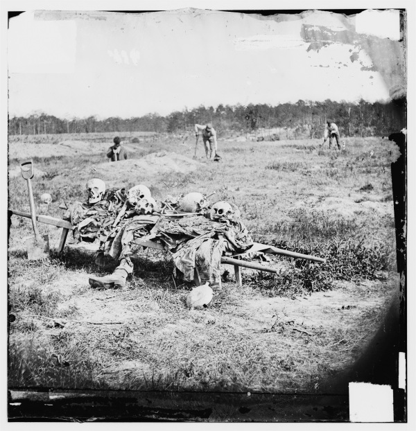 The costs of war. The remains of dead soldiers being collected at Cold Harbor after the war (Library of Congress).