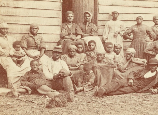 "A group of ex-slaves freed by the advance of the Union armies. Such freed slaves became known as ""contrabands of war"" (Library of Congress)."
