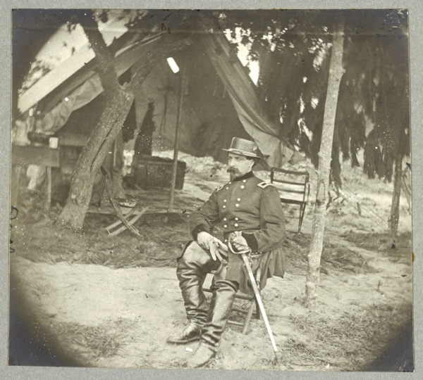 Edward Ferrero sitting in front of his headquarters tent at Petersburg (Library of Congress).