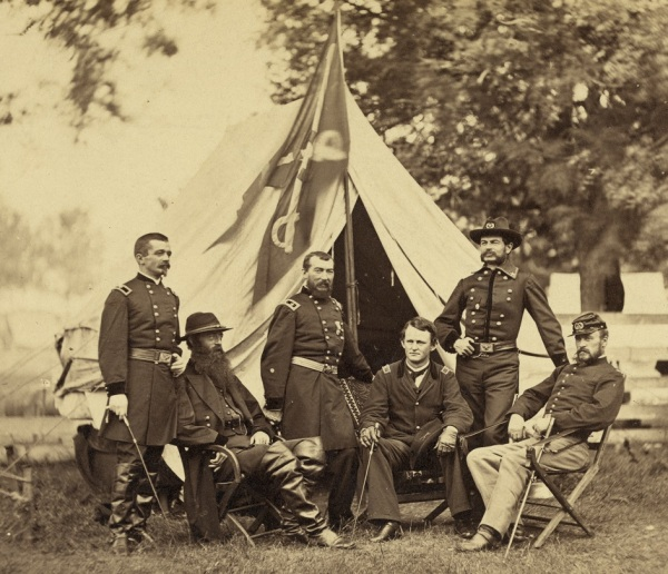 Philip Sheridan and his generals, Henry E. Davies, David McMurtrie Gregg, Wesley Merritt, Alfred Torbert, and James H. Wilson. Tis Brady photograph was probably taken in July 1864 near City Point (Llibrary of Congress).