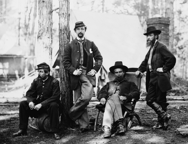 Personnel of the 10th MA Battery (and a guest), taken in December 1863 at Brandy Station. Pictured (left to right)  are Capt. Samuel A. McClellan, Capt. J. Henry Sleeper, Capt. O'Neil W. Robinson, and artist  Alfred R. Waud. Click to enlarge (Library of Congress).