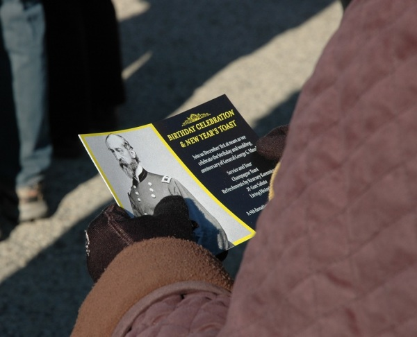 A visitor holds a brochure about the 2014 event (Tom Huntington photo).