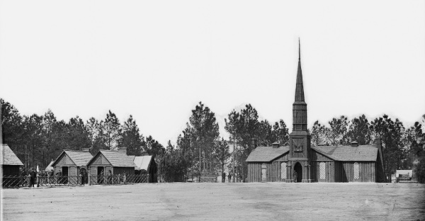 Another view of the very photogenic Poplar Grove Church, with the headquarters of the 50th New York Engineers next to it. Some of the engineers are visible in the photo. Click to enlarge (Library of Congress).