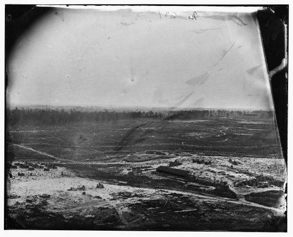 This photo is identified only as a view from a signal tower at Petersburg. Perhaps it's from the tower at Fort Fisher that Lyman mentions in his letter of March 8. It appears to have been taken after the line had been abandoned because the fort appears deserted and all the tent roofs of the cabins have been removed. Click to enlarge and see details (Library of Congress).