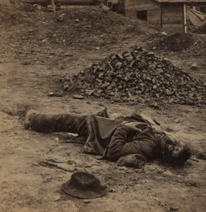 A dead Confederate soldier in the trenches before Petersburg (Library of Congress).
