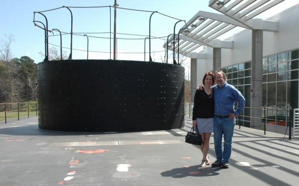 My wife and I pose on the deck of the life-size Monitor mockup.