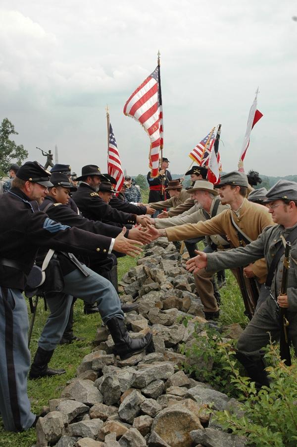 Hands across the wall (Tom Huntington photo).